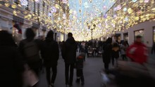 Time Lapse Of A Lot Of People Walking In Urban Area Decorated With Lights