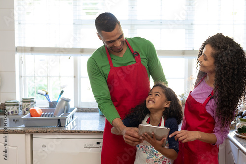 Family in kitchen at Christmas