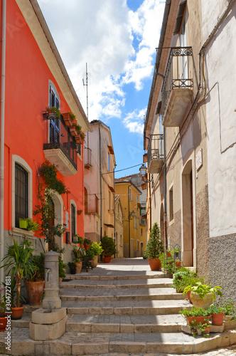 Fototapety, obrazy: Sepino, Italy, 08/14/2017. A small street among the colorful houses of a village in the Molise region