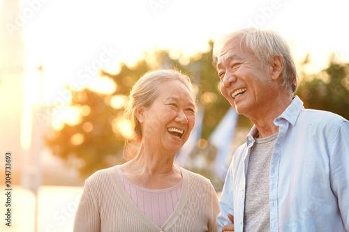 Fototapeta outdoor portrait of happy senior asian couple obraz