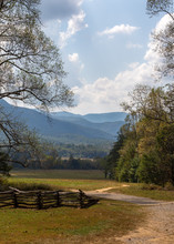 View Over The Great Smoky Mountains From A Historic Log Cabin With A Wooden Fence In The Foreground