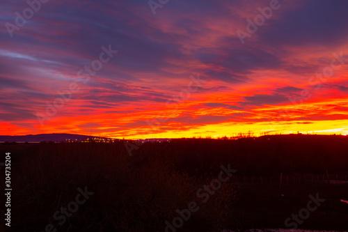 Papiers peints Grenat Sunrise in the desert of El Calafate Argentina