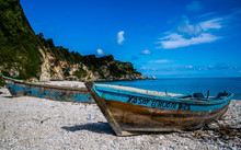 Dramatic Image Of Boat On The Beach Of The Caribbean Coast In A Small Fishing Village
