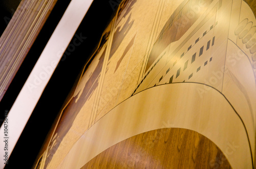 Fotografija  Detail of wooden and beautiful Artdeco Art Deco inlaid wood mural on classic Cun