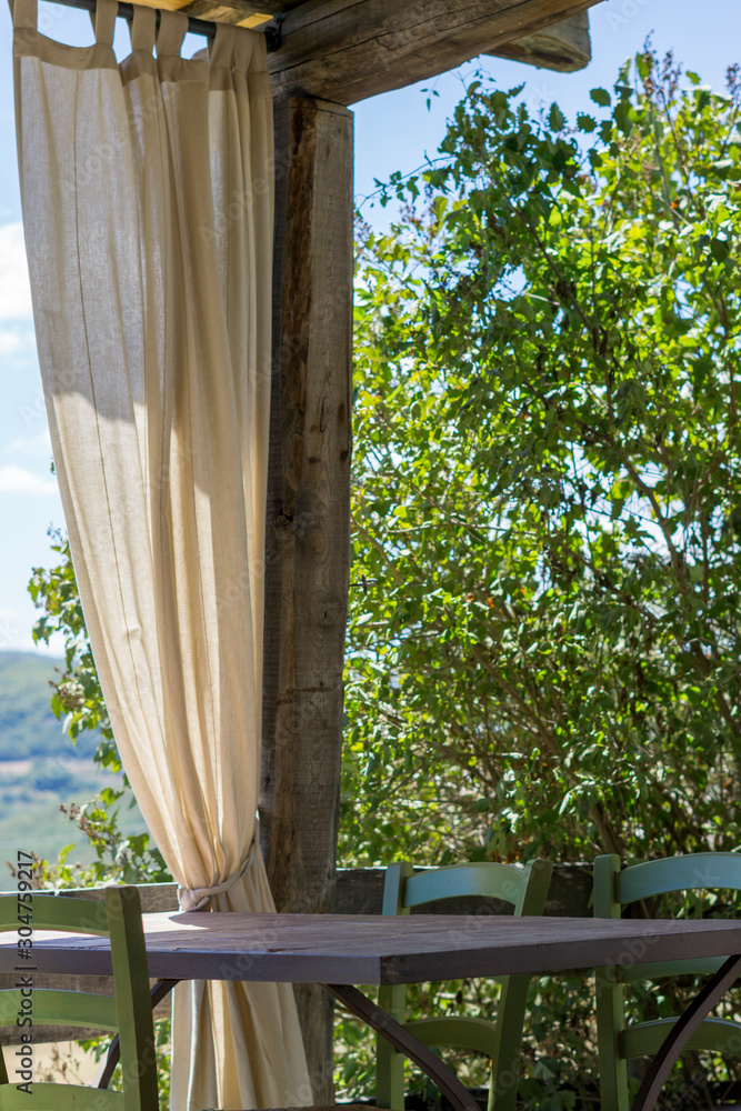 Table and chairs in Tuscan countryside