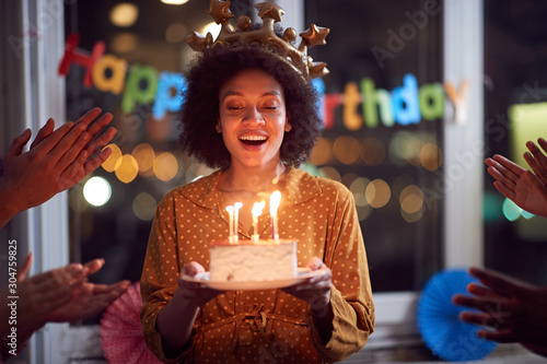 Valokuvatapetti woman blowing out her birthday candles and celebrating Birthday