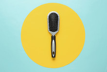 Stylish Hairbrush On Blue Background With Yellow Circle. Women's Hair Care Accessories.