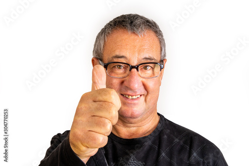 Foto  Man with glasses holds thumb up for approval