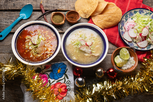 Mexican white  and red pozole with christmas decoration on wooden background Wallpaper Mural