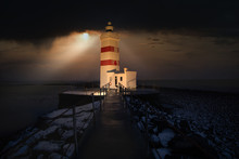 Glowing Lighthouse Shines Brig...