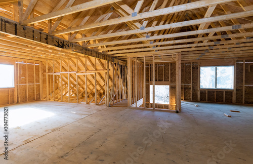 Beam built home under construction with wooden truss, post and beam framework fr Canvas Print