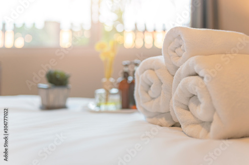 Fototapety, obrazy: White towel on bed in guest room for hotel customer. Towels  in spa or fitness center.