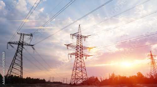 Valokuva High-voltage power lines at sunset or sunrise