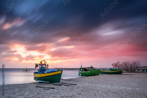 Foto auf AluDibond Blaue Nacht Fishing boats on the beach during sunrise in Gdynia. Baltic Sea. Poland