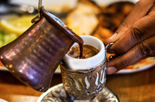 Pouring Turkish Coffee Into Tr...