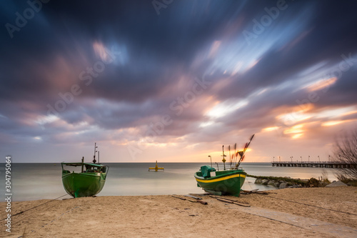 Obraz Fishing boats on the beach during sunrise in Gdynia. Baltic Sea. Poland - fototapety do salonu