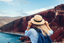 Tourist Looking At Red Beach L...
