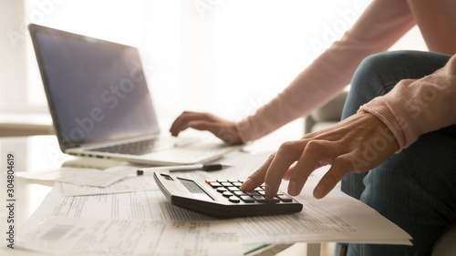 Close up of woman managing home utility bills
