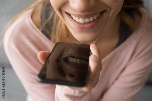 Close up of smiling girl talking on smartphone Wallpaper Mural