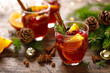 Christmas mulled wine. Traditional festive drink with decorations and fir tree.