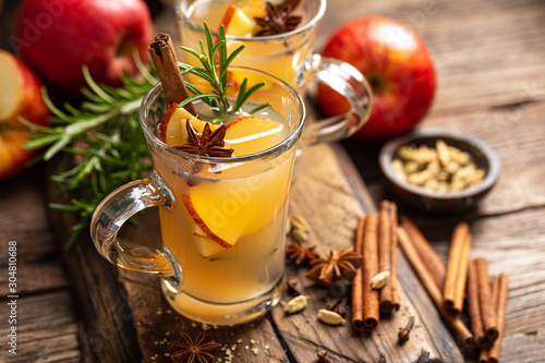 Fototapeta Christmas mulled apple cider with cinnamon and anise, traditional winter warming