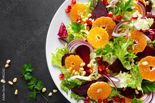 Poster Pays d Europe Christmas salad with boiled beet, red onion, tangerines, pomegranate, parsley, pine nuts and lettuce leaves