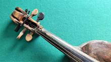 Violin In Vintage Style On Gre...