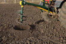 Drilling Holes In Field, Preparing For Trees Planting