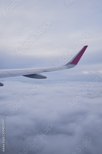 Airplane wing, scenic view from the window. Higher than clouds. Beautiful cloud, blue sky. Traveling by plane, adventure. Flight over Europe. Air transport. Aviation. Holiday in other country. Poster Wall mural