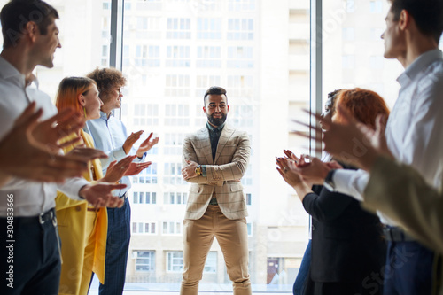 Happy business team clap their hands to co-worker for his great job, business people concept Tableau sur Toile