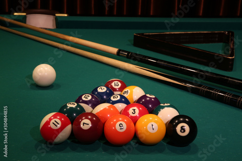 Sports game of billiards on a green cloth Fototapeta