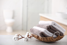 Basket With Fresh Towels On Ta...