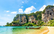 Travel concept. Amazing view of beautiful Ao Nang Beach with longtale boat. Location: Krabi Province, Thailand, Andaman Sea. Artistic picture. Beauty world.