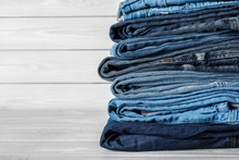 Stack Of Different Jeans On Wh...