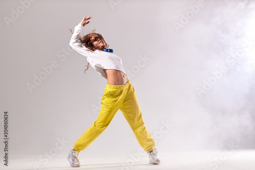Fotografia Charming young professional dance training hard before streetdance competition,