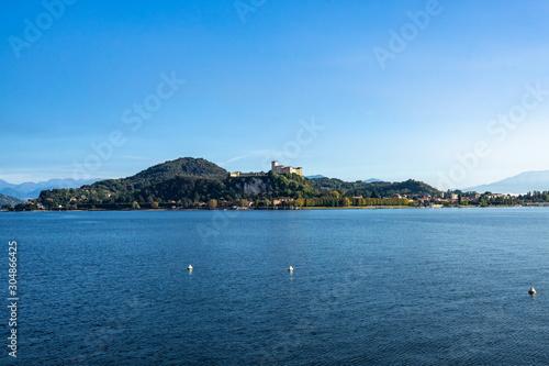 Photo View of Rocca di Angera (Borromeo Castle) from Arona waterfront on the shores of Lake Maggiore, Piedmont, Italy