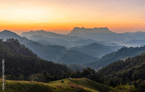 Foto op Plexiglas Grijs Panoramic mountain layers line at morning colorful sky background, landscape