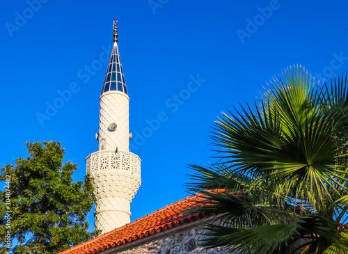 Fotografie, Tablou  Mosque Minaret on a background of blue sky in Bitez, Bodrum, Turkey