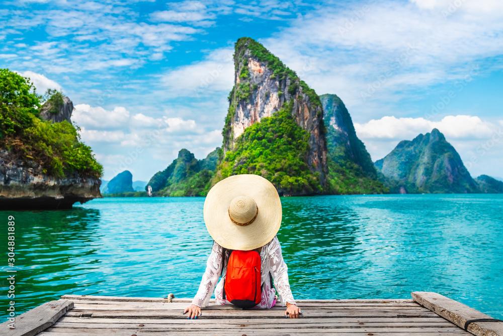 Fototapeta Traveler woman looking amazed nature scenic landscape tropical island Phang-Nga bay Adventure lifestyle tourist travel Phuket Thailand summer holiday vacation  Tourism beautiful destination place Asia