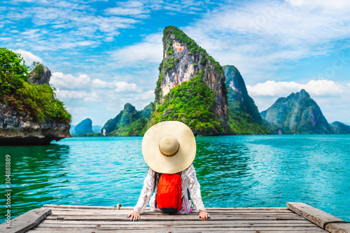 Fotografie, Obraz  Traveler woman looking amazed nature scenic landscape tropical island Phang-Nga