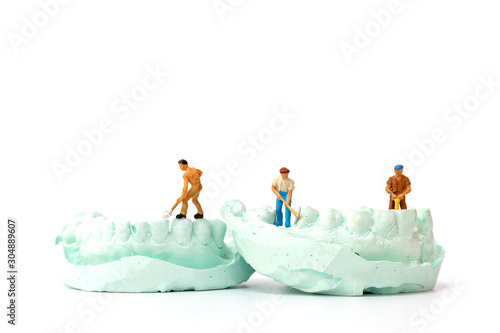 Miniature people : Worker team repairing a tooth ,Healthcare and medical concept Canvas Print
