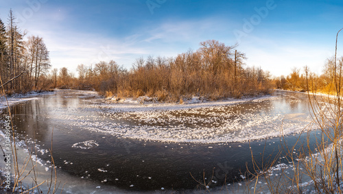The first clear river ice is dotted with fluffy crystals of frost Canvas Print