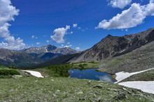 A Small Alpine Lake High Up In The Rockies With The Summit Of Mt. Yale Looming In The Background.