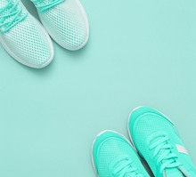 Sporty Fashion Shoes On Mint Color Background With Copy Space.