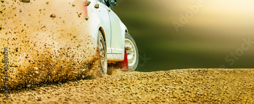 Fotografía  Rally race car drifting on dirt track.