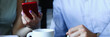 business people in cafe coffee break at table hold mobile phone in arms
