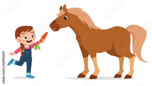 Fototapeta happy cute kid girl feeding cute horse obraz