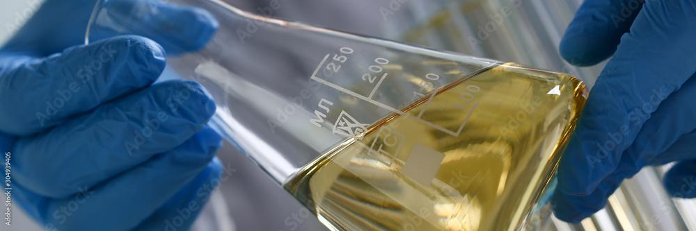 Fototapeta Yellow liquid spilled petrol additive innovative supply