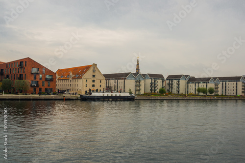 COPENHAGEN, DENMARK: Beautiful panoramic view from the waterfront to the buildings, boats and the river Canvas Print