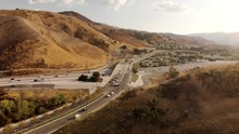 Aerial Of Busy Highway Cutting...